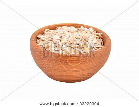 Oatmeal in a wooden bowl