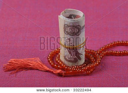 An UAE Dirhams and islamic rosary