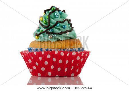 Colorful Christmas cupcake with balls and tree