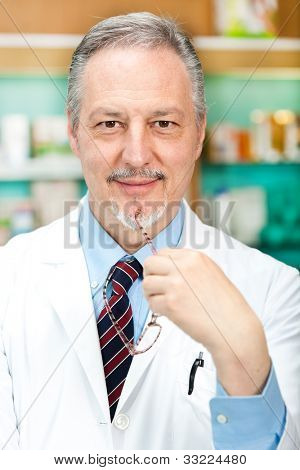 Portrait of a friendly chemist in his store