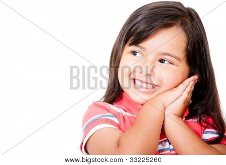 Pensive little girl daydreaming - isolated over a white background