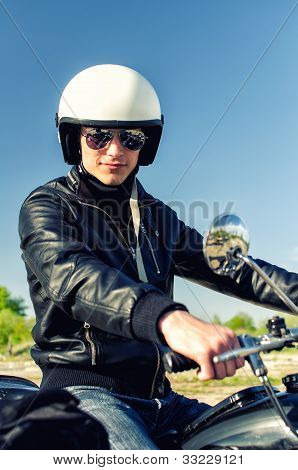 Motorcycle Cop In A Helmet And Goggles