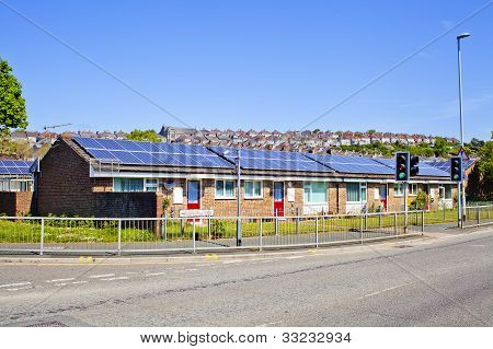 solar panels on the roofs of bungalows