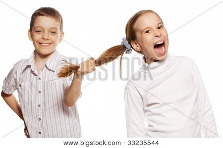 Boy pulls the girl's hair isolated on white background. Children's conflict