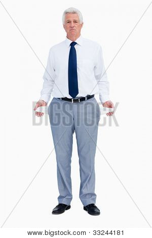 Portrait of a businessman with empty pockets against white background