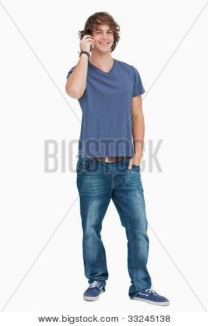 Happy male student on the phone against white background