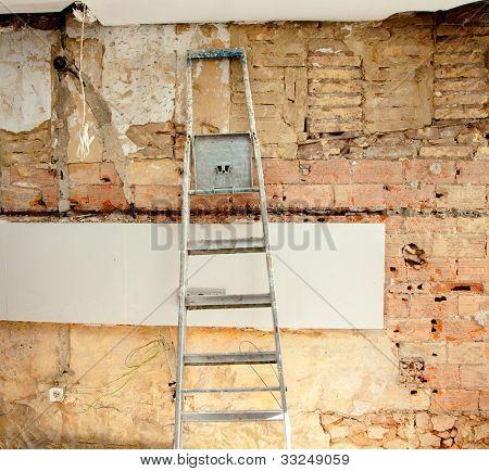 demolition debris in kitchen interior construction and ladder