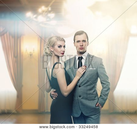 Retro couple in luxury interior