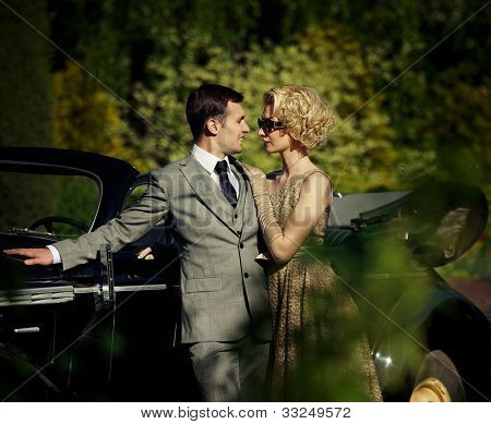 Couple near a retro car outdoors