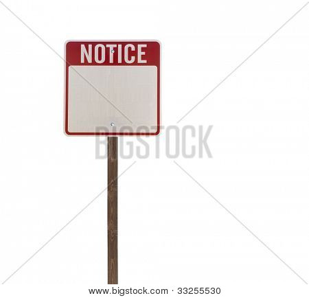 Tall isolated notice road sign on a wooden post.