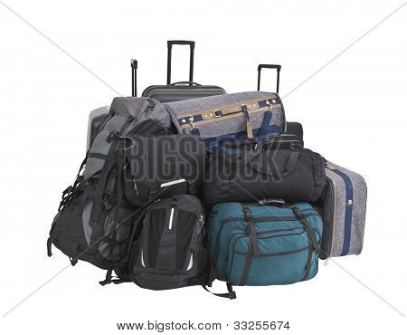 Large pile of suitcases, luggage, bags and backpacks isolated.