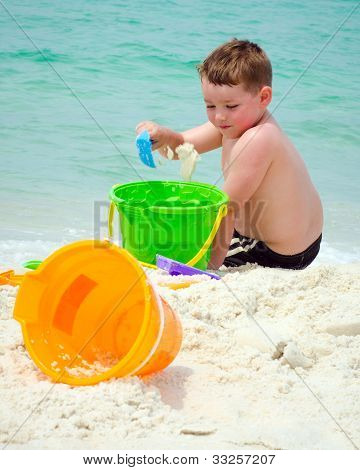 Child playing in the sand at beach