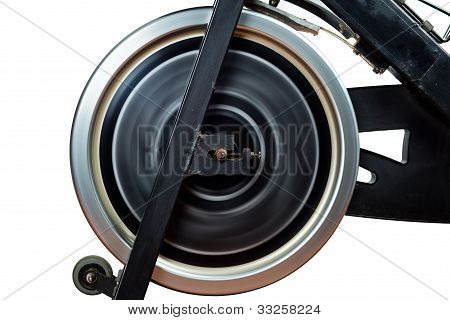 Aged Spinning Bike Flywheel Rotating. Front Detail.