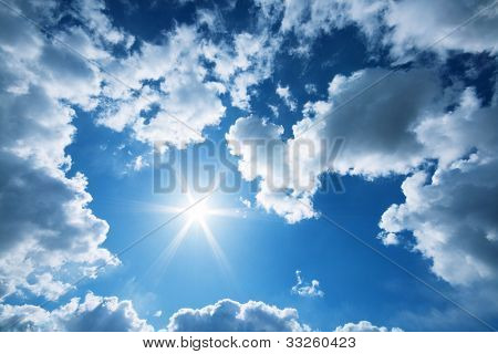 Sun and clouds in a blue sky