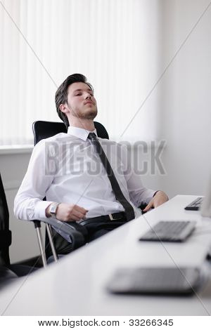 Portrait of a young business man looking depressed and worried from work at meeting office indors