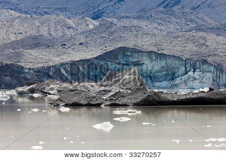 Glacier tongue calfing icebergs into glacial lake
