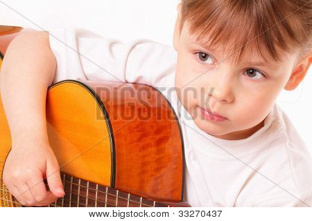 Beautiful Little Girl Plays Guitar