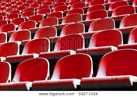 red plastic chairs at the stadium