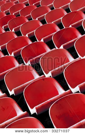Red plastic stadium chairs