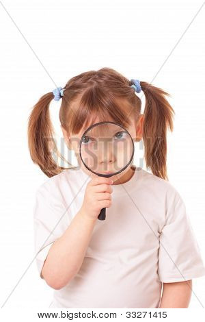 Little Girl With A Very Big Magnifying Glass