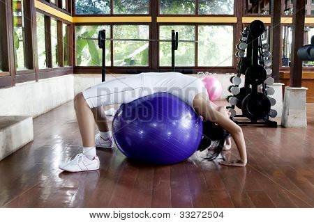 Woman Excercising With Swiss Ball