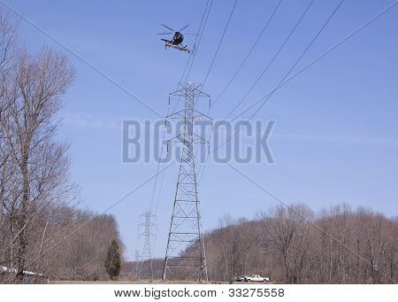 NEWTON, NJ - APR 9: A helicopter team spends the day preparing power lines to be replaced in Newton, NJ on April 9, 2011.