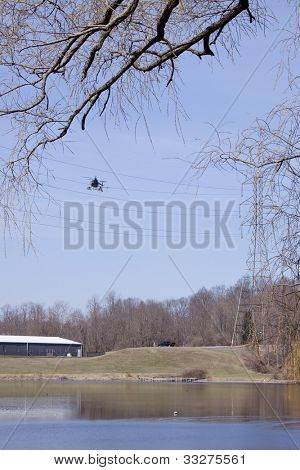 NEWTON, NJ - APR 9: A helicopter team spends the day preparing power lines over a lake to be replaced in Newton, NJ on April 9, 2011.