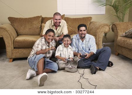 Multi-generational Hispanic male family members playing video games