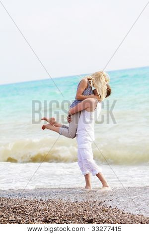 happy young couple on beach