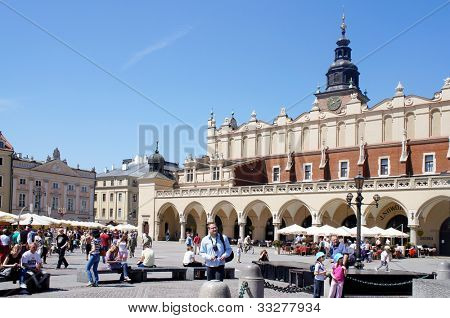 KRAKOW, POLAND - MAY 20: City Square with Old Market hall on May 20, 2012 in Krakow, Poland. City Square it is the largest medieval town square in Europe, visited by tourists from around the world.