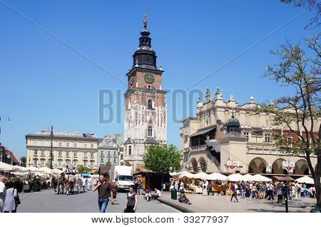 KRAKOW, POLAND - MAY 20: City Square with the Town hall on May 20, 2012 in Krakow, Poland. Main City Square it is the largest medieval town square in Europe, visited by tourists from around the world.