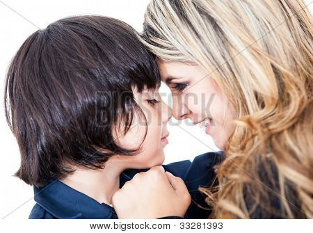 Potrait of a mother and son giving an eskimo kiss - isolated over white
