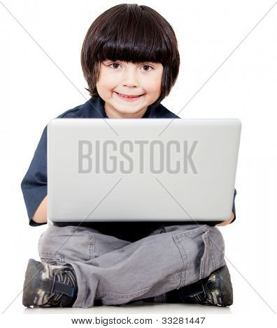 Boy with a laptop computer - isolated over a white background