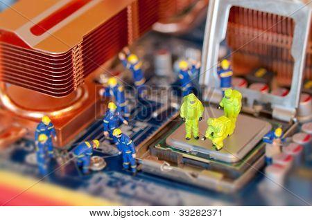 Technicians Repairing Computer