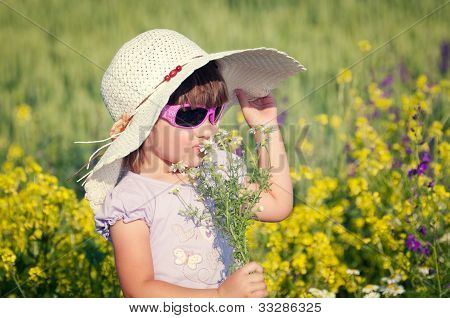 Smile girl in rape field