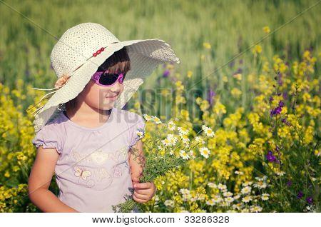 Smile girl in rape field