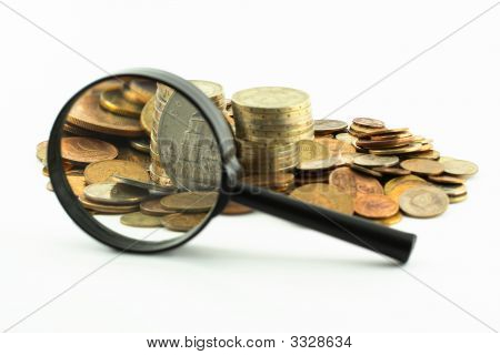 Coins And Magnifying Glass