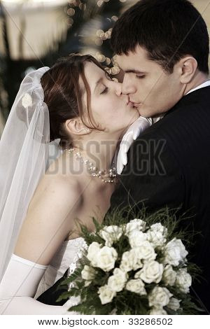 Kissing newlywed couple