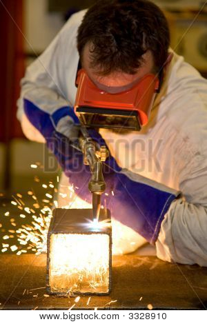 Welder Cutting With Flame