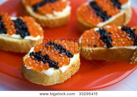 Caviar Snacks On A Red Plate