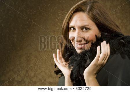 Pretty Hispanic Woman Wearing Feathers