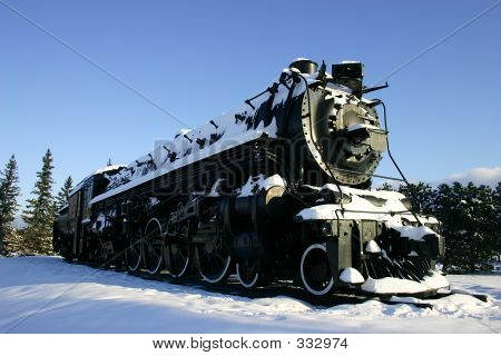 Old Locomotive In The Snow