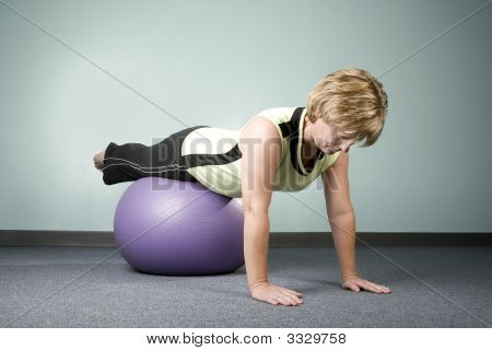 Woman Balancing On An Exercise Ball