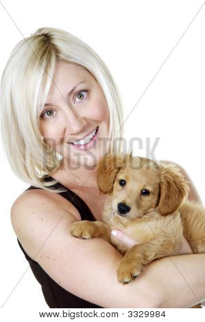 Beautiful Girl Holding Minature Golden Doodle Puppy
