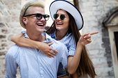 Tourist Couple In Love Enjoying City Sightseeing At Summer poster