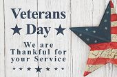 Veterans Day Thank You For Your Service Message With Old Retro Star On A Weathered Whitewash Wood poster