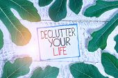 Handwriting Text Declutter Your Life. Concept Meaning To Eliminate Extraneous Things Or Information  poster