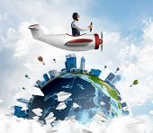 Man In Aviator Hat With Goggles Driving Propeller Plane. Earth Globe With High Modern Buildings. Fun poster