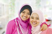 stock photo of muslimah  - Happy Muslim women standing inside house - JPG