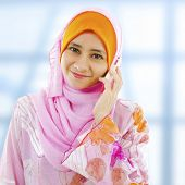 foto of muslimah  - Muslim business woman on the phone - JPG